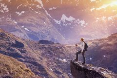 Norway hike, young woman traveler with backpack standing on the Stock Photo