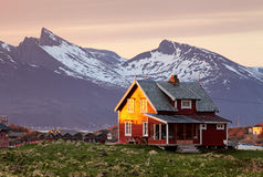 Norway house with mountain in background Royalty Free Stock Photography