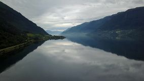 Norway - ideal fjord reflection in clear water from drone on air stock footage