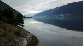 Norway - ideal fjord reflection in clear water from drone on air stock video footage