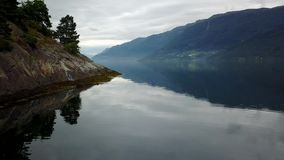 Norway - ideal fjord reflection in clear water from drone on air stock video