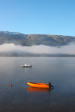 Norway lake with fog and mountains Stock Photos