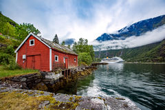 Norway landscape, the house on the shore of the fjord in the bac Stock Photo