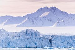Landscape ice nature of the glacier mountains of Spitsbergen Longyearbyen Svalbard arctic ocean winter polar day sunset sky. Norway landscape ice nature of the royalty free stock image