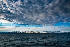 Norway landscape ice nature of the glacier mountains of Spitsbergen Longyearbyen Svalbard arctic ocean winter polar day sunset sky. Sun set stock images