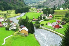 Norway landscape with mountains, river and houses Stock Photo