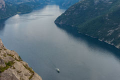 Norway Landscape. Preikestolen. River and Tourist Ferry in Background. Mountain. Blue sky. Stock Photography