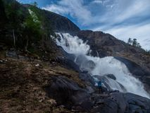 Norway - Langfossen waterfall and a little human royalty free stock image
