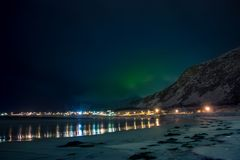 Lights of the Village are Reflected in the Night Fjord stock images