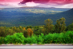 Norway mountain transportion road with bokeh and pink sunset bac Royalty Free Stock Image