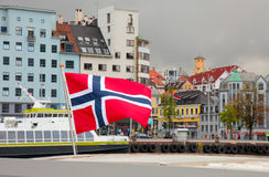 Norway National Flag Waving In Norwegian City Bergen, Scandinavia, Scandinavian Europe Nordic Town Travel European Cityscape Fjord Royalty Free Stock Photography