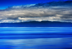 Norway ocean tidal waves with horizon mountain abstraction. Hd Stock Photography