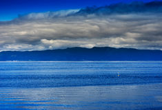 Norway ocean tidal waves with horizon mountain landscape backgro. Und hd Stock Images