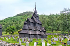 NORWAY, OLD CHURCH. NORWAY - JULY 26 - 2015: Old Stave Church in Norway near the road on cloudy day Stock Images