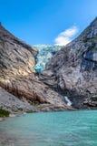 Briksdal glacier, Norway. Norway, Olden landmark nature gem, lake and Briksdal or Briksdalsbreen glacier with melting blue ice and lake royalty free stock image