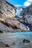 Briksdal glacier, Norway. Norway, Olden landmark nature gem, lake and Briksdal or Briksdalsbreen glacier with melting blue ice royalty free stock photography