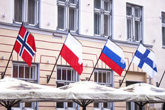 Norway poland russia finland flag. Above a restaurant in estonia Stock Images
