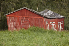 Norway. Red wooden rustic abandoned and curved farm house countr Royalty Free Stock Image