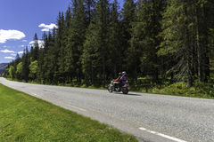 Norway Route Traffic. A lonely road in Norway with some cars and motorcycle Royalty Free Stock Photo