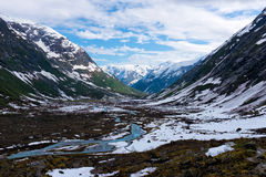 Norway scenic mountain landscape. With a glacier river in the valley Stock Photo