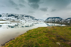 Norway scenic mountains with frozen lake. Royalty Free Stock Image