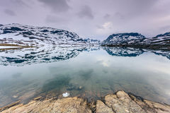 Norway scenic mountains with frozen lake. Stock Images