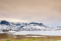 Norway scenic mountains with frozen lake. Stock Photo