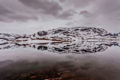 Norway scenic mountains with frozen lake. Stock Image