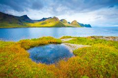 Norway seascape. Sunny landscape with rocks and clean blue sea. Famous Lofoten islands of Norway. Northern nature. Spring landscape. Sunny nature background stock image