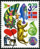 NORWAY - 1997: shows insect, butterfly, fish, flag, hand holding pen, heart, tiger, horn, boy with dog, globe, Junior Stamp Club. NORWAY - CIRCA 1997: A stamp royalty free stock photography