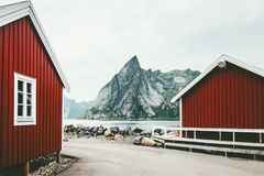 Norway traditional architecture house rorbu and rocky mountains. Scandinavian travel view landscape Stock Photos
