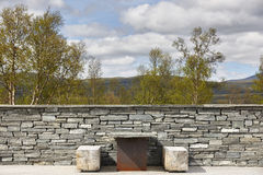 Norway travel picnic area with stone wall. Natural environment Stock Images