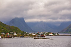 Norway village on a fjord. Nordic cloudy summer day. Stock Image