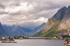 Norway village on a fjord. Nordic cloudy summer day. Royalty Free Stock Photos