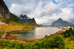 Norway village on a fjord. Nordic cloudy summer day. Stock Photos