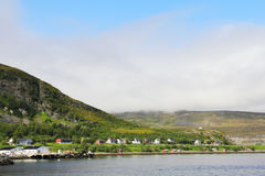Norway village. Picturesque view on small village in fjord of Norway Royalty Free Stock Image