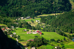 Norway village. Scenery near Flam and Aurland - Norway, Scandinavia, Europe. Beautiful fjord and  small village on a lake coast Royalty Free Stock Photography