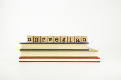 Norwegain language word on wood stamps and books Royalty Free Stock Photos