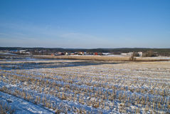 Norwegian agricultural landscape in the winter. A typical Norwegian agricultural landscape in the winter. In the background of the fields seems farms, frozen Stock Photo
