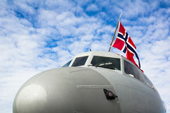 Norwegian air force. Military airplane with flag of Norway. Bottom view of nose cone from front side Royalty Free Stock Photo