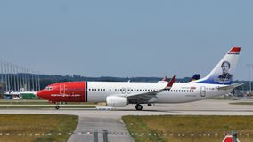 Norwegian Air Line plane takes off from Munich MUC Airport. Norwegian Air jet taking off from Munich Airport, spring time royalty free stock images
