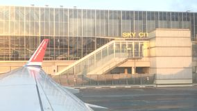 Norwegian Airlines jetliner on tarmac ready for takeoff outside Sky City