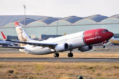 Norwegian airlines maniobre of elevation in final terminal piste of alicante airport Royalty Free Stock Photography