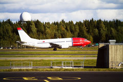 Norwegian airplaine. A plane from Norwegian Air Shuttle is taking off at Gardermoen Airport outside Oslo, Norway Royalty Free Stock Image
