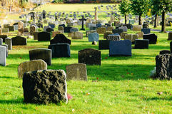 Norwegian autumn cemetery tombstones Stock Images