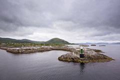 Norwegian bay with lighthouse Stock Images