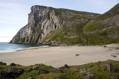 Norwegian beach. With mountains on a sunny day Stock Photos
