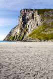 Norwegian beach. With mountains on a sunny day. It´s a vertical picture Stock Photo