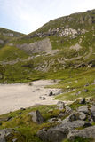 Norwegian beach. With mountains on a sunny day. It´s a vertical picture Royalty Free Stock Image