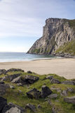 Norwegian beach. With mountains on a sunny day. It´s a vertical picture Royalty Free Stock Photography